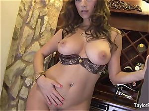 huge-titted brown-haired Taylor Vixen teases the camera