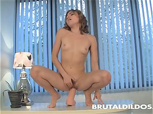 magnificent brown-haired with unshaved coochie finishes off from thick dildo