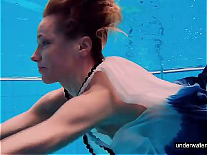 teen doll Avenna is swimming in the pool