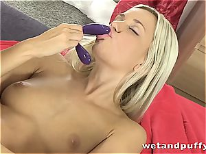 honey in white stocking kneads herself with fake penis