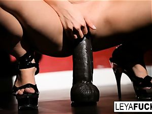 Leya takes on a ample black plaything