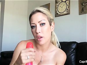 Capri plays with her enormous faux-cock
