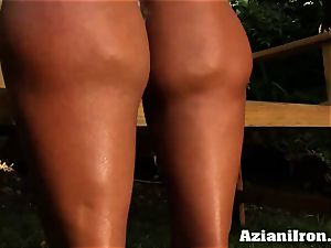 wonderful muscular Amber undresses down and massages her humungous pleasure button