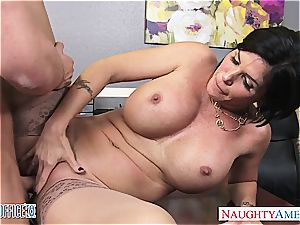 stunning brunette cougar Shay Fox gives head