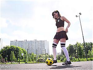 Jeny Smith frolicking some football