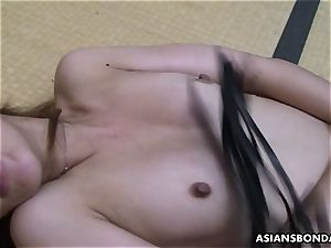 asian sadist playthings her furry vulva while being cropped
