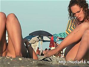 bare beach spycam shoots cuties with a hidden cam
