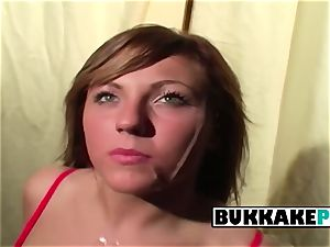 Becky smirks while several dudes urinate and jizz all over her trampy face