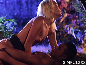 Cecilia Scott in a sensuous scene with a hunky guy