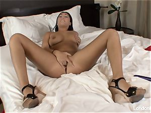 Pierced japanese London Keyes plays with her coochie in couch