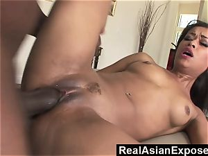 RealAsianExposed little dame opens her