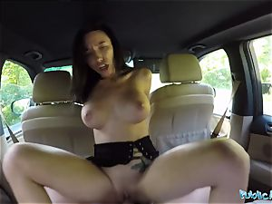 dark haired babe gets pummeled in the car