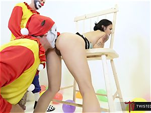 Dana Vespoli poked by creepy immense wood clowns